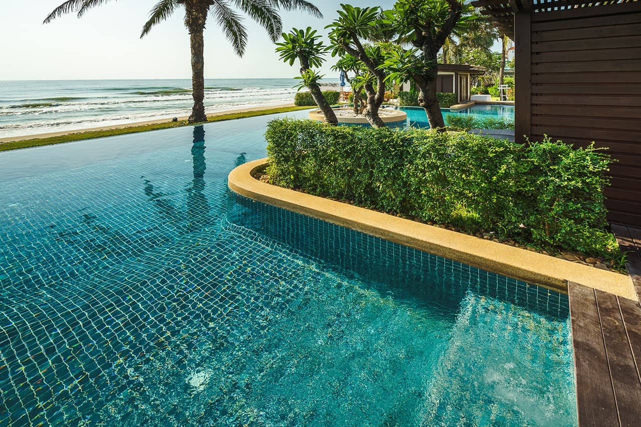 View from Frangipani Residences Swimming Pool onto Beach - Aleenta Hua Hin resort