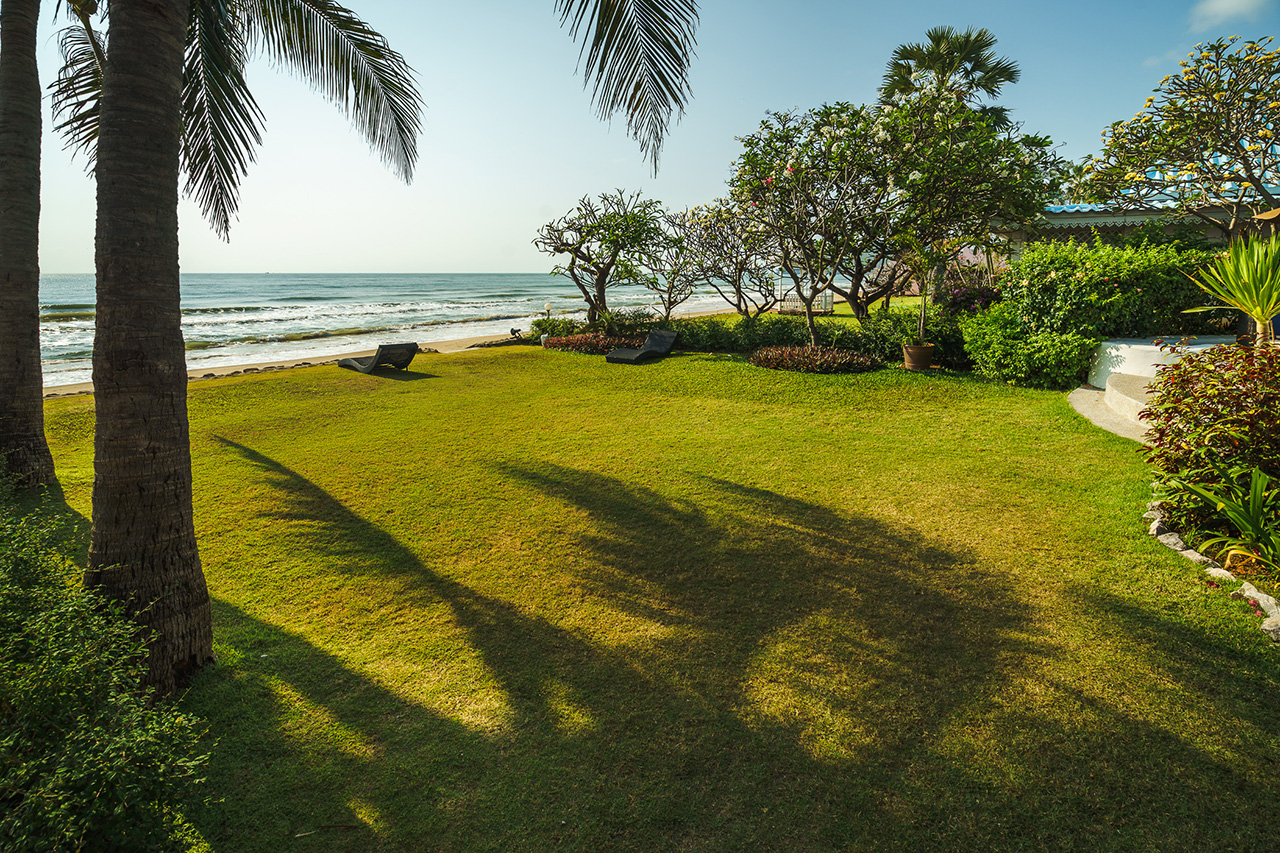 View across private lawn to beach from villa - Aleenta Hua Hin Resort & Spa