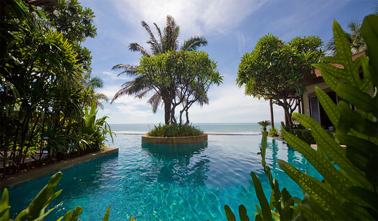 View across swimming Pool to the sea, accessed via two bedroom frangipani suite - Aleenta Hua Hin Resort & Spa