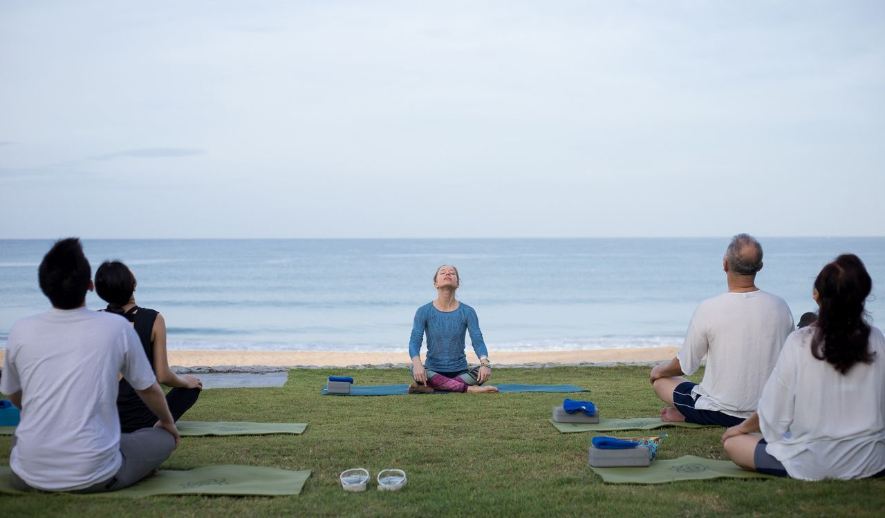 Morning Yoga on the beach - Aleenta Phuket